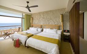 interior design tropical guest bedroom with small ocean view