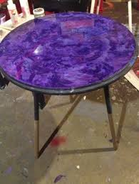 paint glass table top make this little side table with wood discs and a tall candlestick