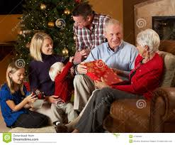 multi generation family opening presents stock images