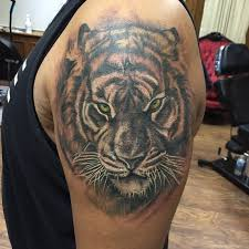 cap1 tattoos tattoos black and grey tiger cover up