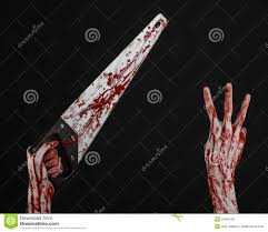 halloween themed background free halloween theme bloody hand holding a bloody saw on a black