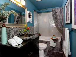 modern bathroom design with blue painted walls and black granite