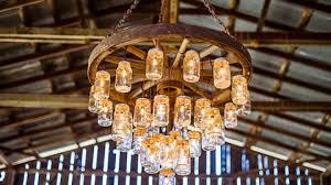 wagon wheel light fixture brilliant wagon wheel chandelier made with mason jars
