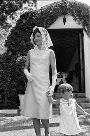 john f kennedy jr holds his mothers hand u s first lady