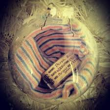 baby s hospital bracelet and hat inside a ornament