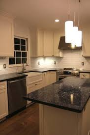 Granite Countertops And Backsplashes by Blue Pearl Granite Counter With White Subway Tile Backsplash Low