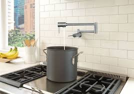 delta faucet bathroom kitchen faucets showers toilets parts with a 4 gpm flow rate the delta pot filler faucet makes it quick and easy to fill pots for cooking and 24 inch dual swing joints allow the pot filler to
