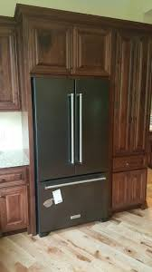 what color cabinets match black stainless steel appliances kitchenaid black stainless appliances with cherry cabinets
