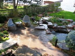Backyard Flagstone Patio Ideas by Floor Flagstone Patio With Waterfall And Stone Chairs Plus Stones