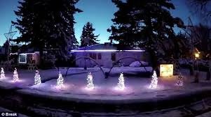 video shows christmas lights show that is synced with megamix of
