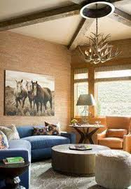 rustic western home decor ideas with chandelier and horse wall