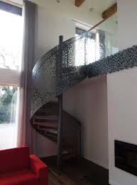laser cut screen spiral staircase design by miles and lincoln