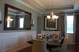 fabulous formal dining room with beautiful tray ceiling and crown