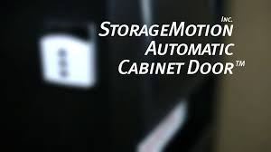 automatic cabinet door an electric motor driven cabinet door