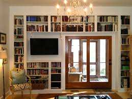 under tv shelves integrated with home library design idea picture