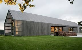 modern home design sustainable barn house shaped exterior photo