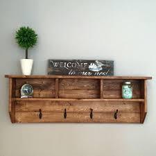 wall hanging coat rack shelf hooks with storage baskets to