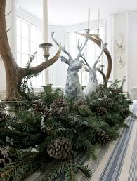 carolyne roehm reindeer figureines with greenery pinecones and anters by