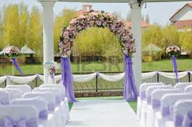 Wedding Arches And Arbors Wedding Arbor With A Flower Arch And White Chairs Stock Photo