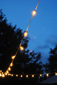 string lights outdoor how to hang outdoor string lights the deck diaries part 3