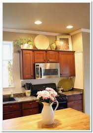 kitchen decorating above kitchen cabinets for stylish decorating