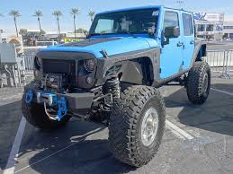 midnight blue jeep every jeep on the front lot at sema show 2017 quadratec