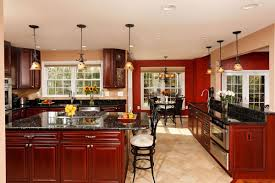 holiday tested kitchen centric open floor plan well suited for by replacing a load bearing wall with a micro laminate beam attached to concealed vertical supports remodeler michael nash introduced an open plan that