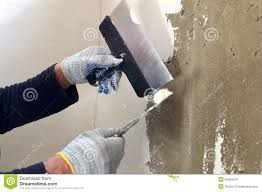 wall putty the process of the concrete wall putty two spatulas stock photo