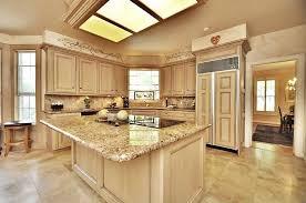 Mediterranean Kitchen Cabinets - mediterranean kitchen with skylight u0026 stone tile in sugar land tx