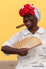 smoke fan for cigars a cigar smoking woman poses with a fan in havana cuba mes petits