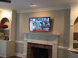 tv wall mounting charlotte nc tv mounted on brick fireplace