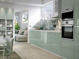 A Medium Size Kitchen With Light Green Highgloss Doors And - Ikea stainless steel kitchen cupboard doors