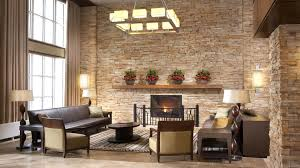 living room modern living room with stone fireplace faux leather