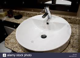 white modern luxury bathroom sink chrome facet stock photo