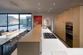 large levin residence unitary room showing parallel kitchen dining