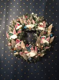 martha stewarts village wreath with putz houses and bleached trees