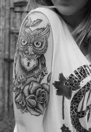 grey ink sunflower tattoo on waist photos pictures and sketches