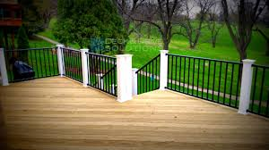 treated deck with black westbury railing and white posts des