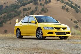 cars mitsubishi lancer mitsubishi lancer evolution yellow car 4k wallpapers new hd