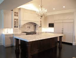 White Kitchen Cabinets With Black Island by Attractive Black Kitchen Island With Granite Top Dark Gallery