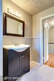 traditional powder room with specialty door undermount sink in