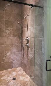 Tile Shower Door by Luxury Tile Shower With Glass Door Stock Photo Picture And