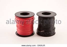 spool of copper electrical wire with black insulation stock photo