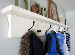 home design built in entryway bench and coat rack tv above