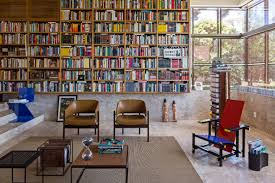 modern home library photo 3 of 7 in this cor ten house in brazil would not be complete