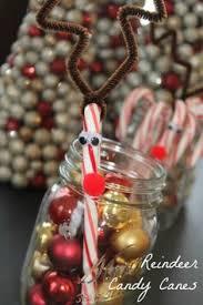pom pom candy cane christmas craft for kids candy canes craft
