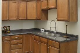 Burkett Pecan Kitchen Cabinets Surplus Warehouse - Kitchen cabinets warehouse