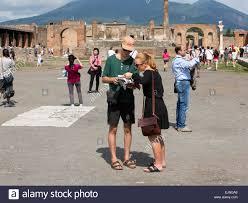 Pompeii Map Pompeii Naples Italy Tourists Reading Map Mount Vesuvius Stock