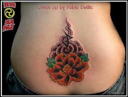 lower back flower tattoo design for women tattoomagz