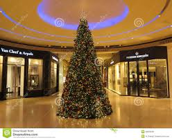 christmas tree inside view of shopping mall editorial stock photo